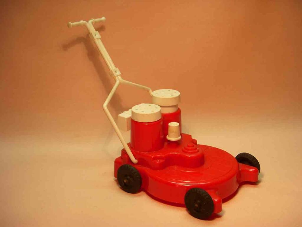 Vintage plastic lawn mower salt and pepper shakers