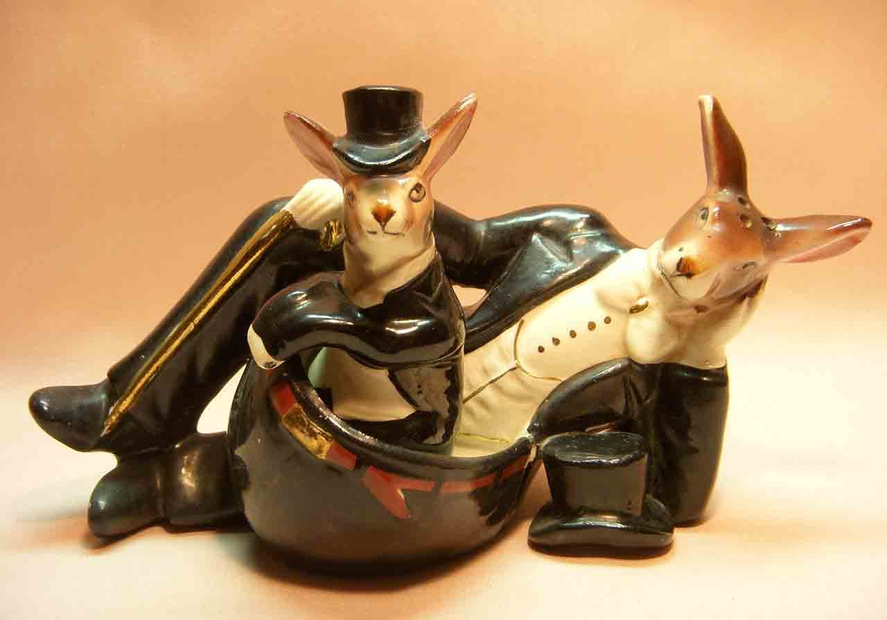 Nester kangaroo with joey nesting in pouch wearing tuxedos salt and pepper shaker