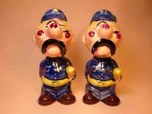 Clown-like strange fellows salt and pepper shakers - police officers