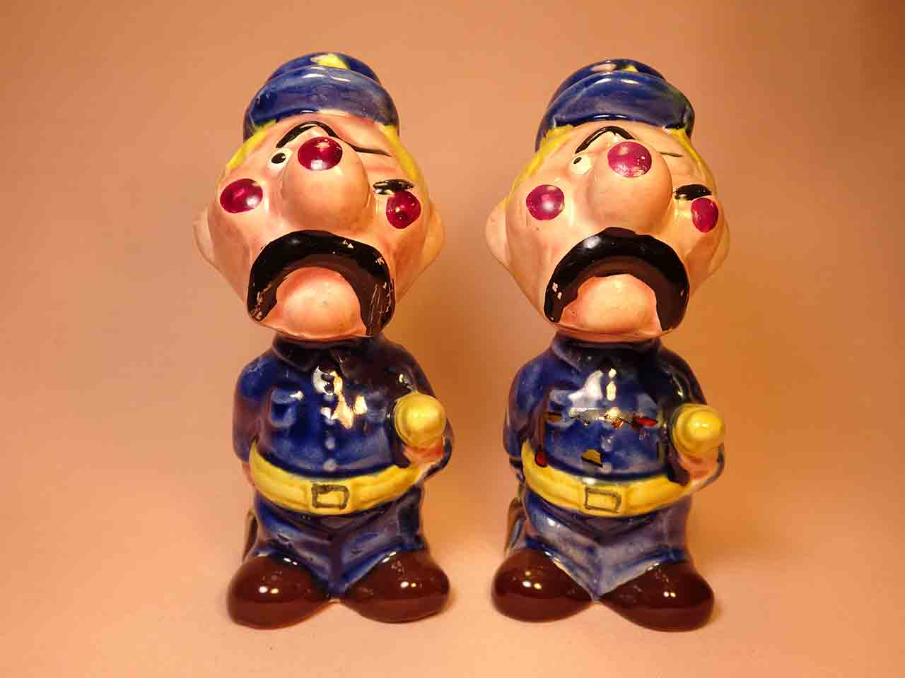 Clown-like strange fellows salt and pepper shakers - police officers