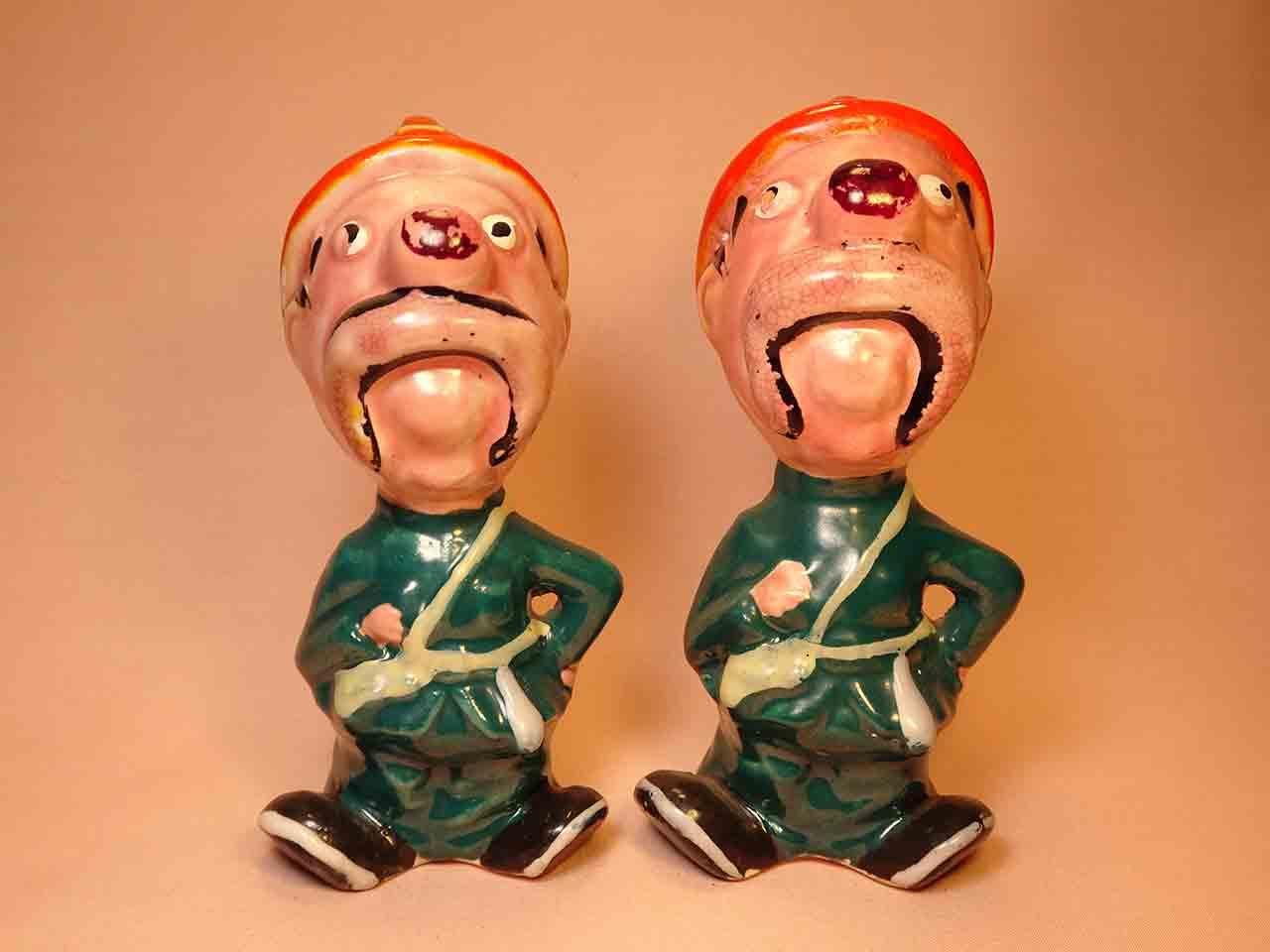 Clown-like strange fellows salt and pepper shakers - firemen