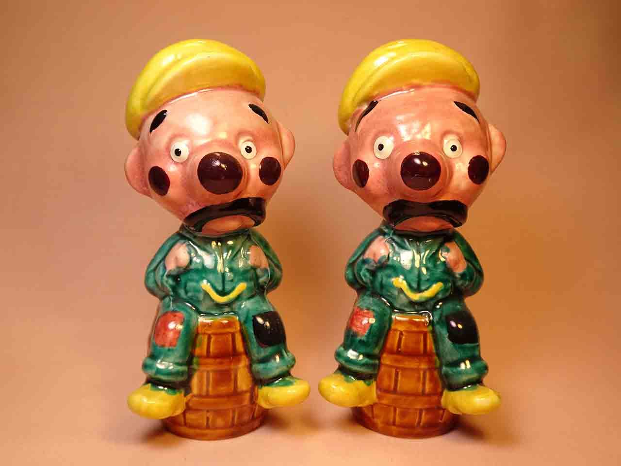 Clown-like strange fellows salt and pepper shakers - guys on barrels