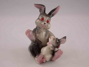 Mother rabbit holding bunny in lap salt and pepper shakers
