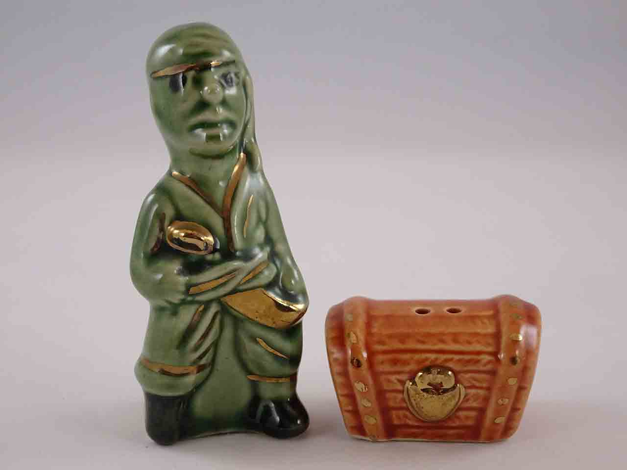 Go with pirate and treasure chest in gold trim salt and pepper shakers