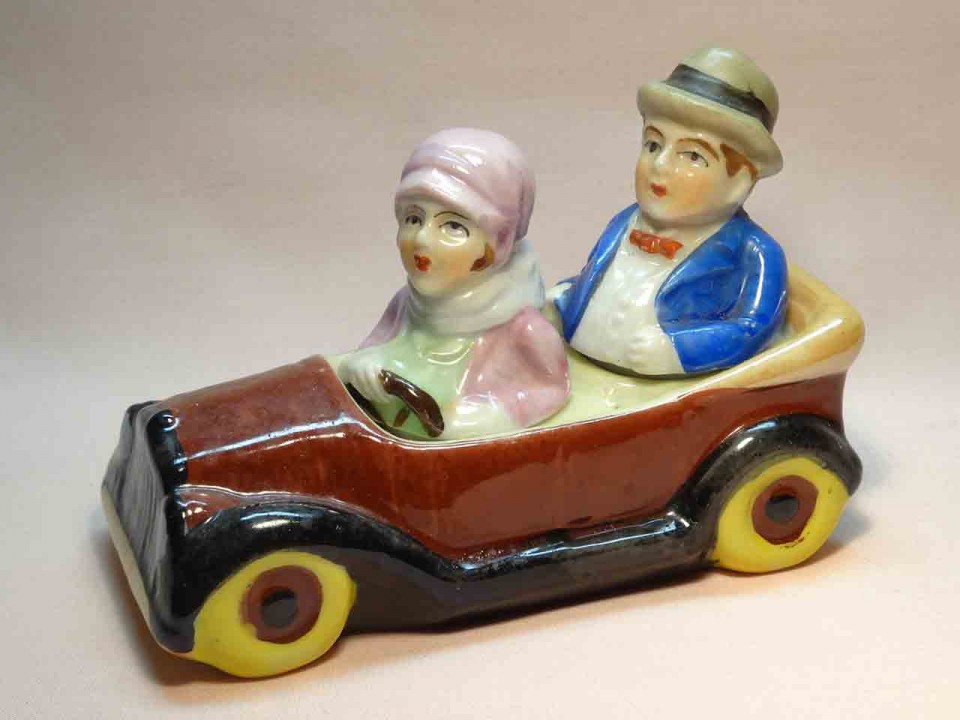 Couple in car condiment salt and pepper shakers