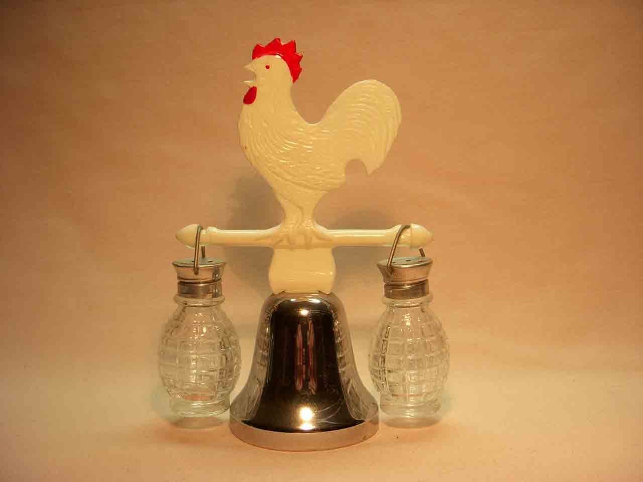 Plastic rooster on dinner bell with hanging salt and pepper shaker