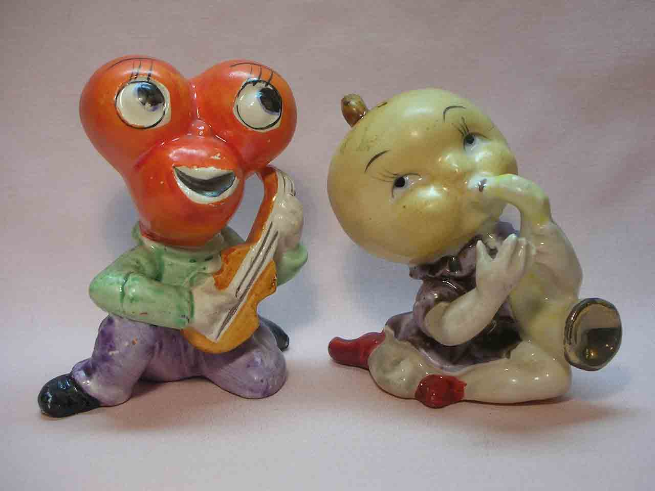 Anthropomorphic cherry and fig guys playing instruments salt and pepper shakers