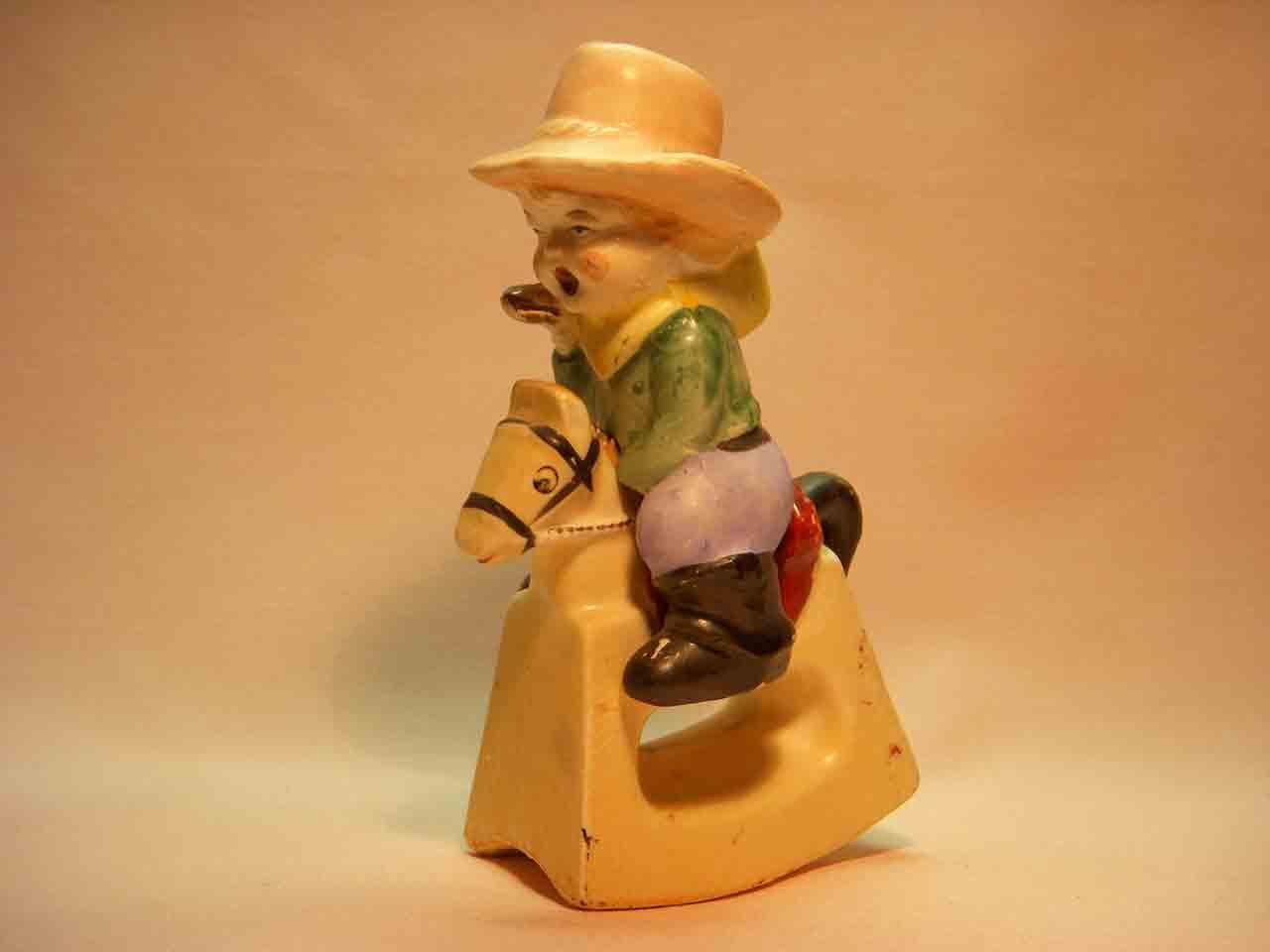 Cowboy kid on rocking horse salt and pepper shaker