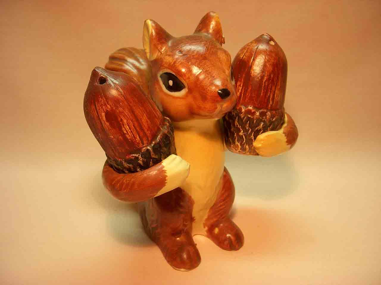 Squirrel holding acorns salt and pepper shaker