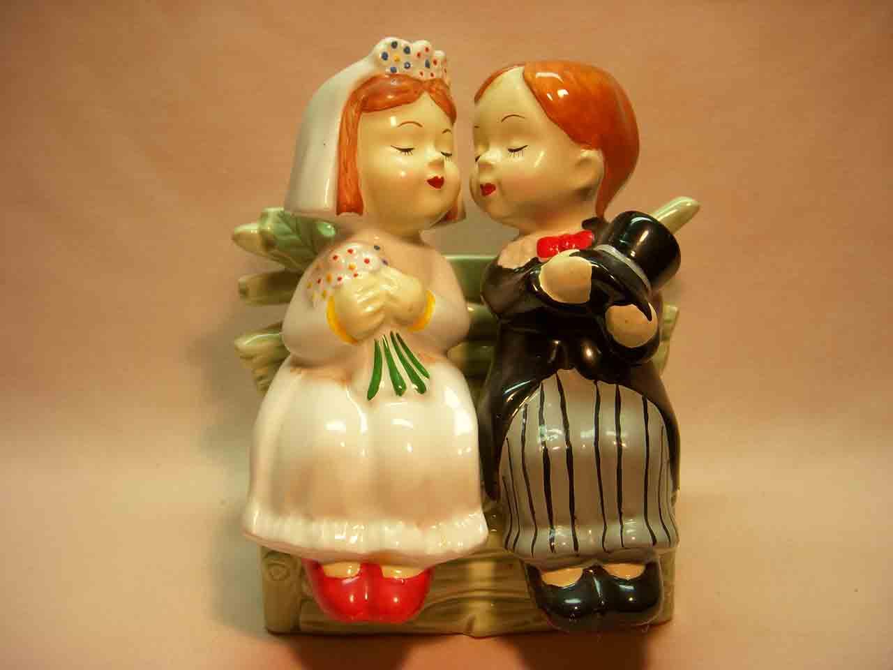 Wedding bride and groom sitting on ceramic bench salt and pepper shaker