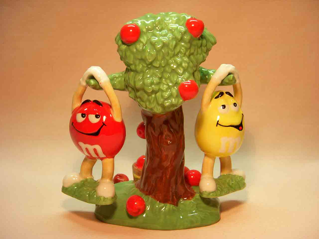 M&Ms candy guys hanging from apple tree for Fall salt and pepper shakers