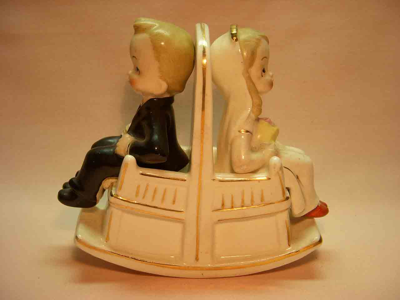 Bride and groom sitting in double rocking chair salt and pepper shaker