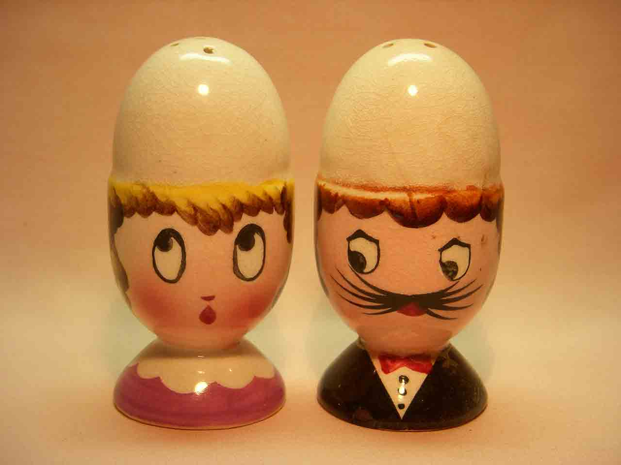 Eggs in egg cup heads salt and pepper shaker