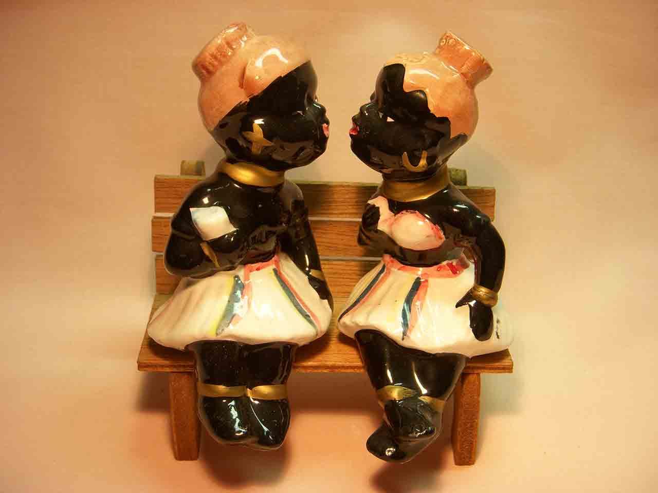 Black natives kissing sitting on wooden bench salt and pepper shaker