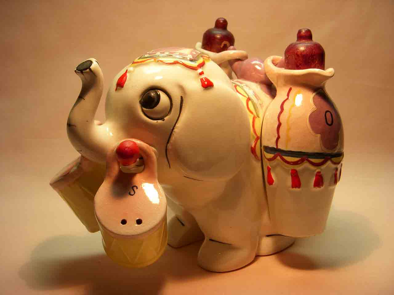 Elephant carrier with hanging oil and vinegar salt and pepper shaker