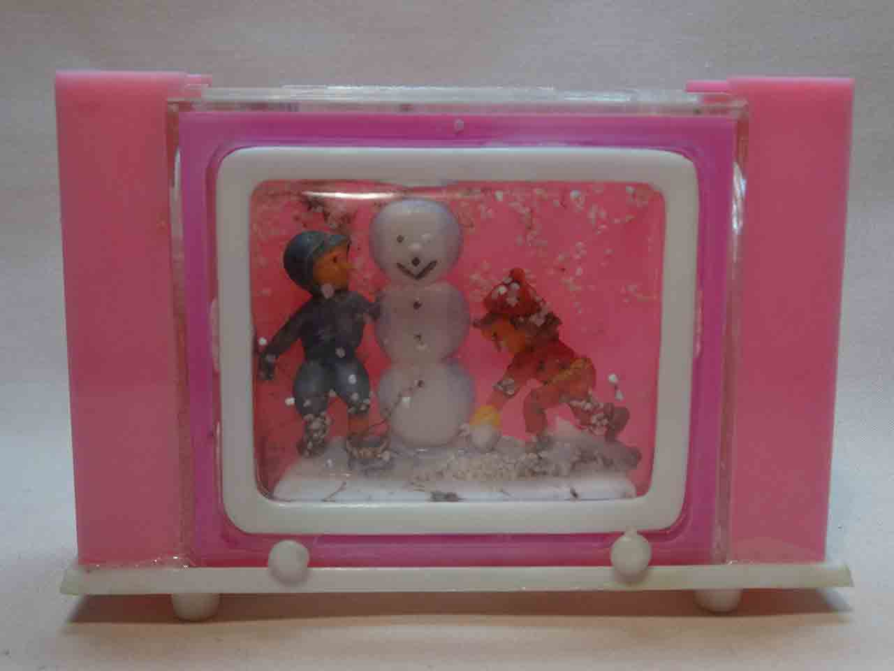 Kids in snow with snowman snow globe salt and pepper shaker