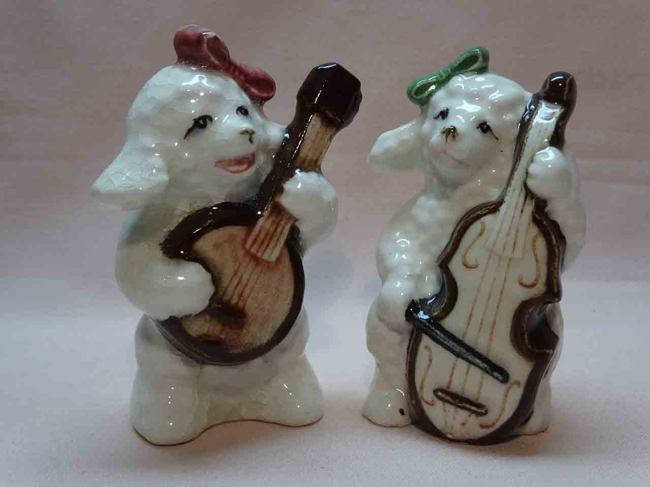 Poodle dogs playing banjo and cello salt and pepper shakers