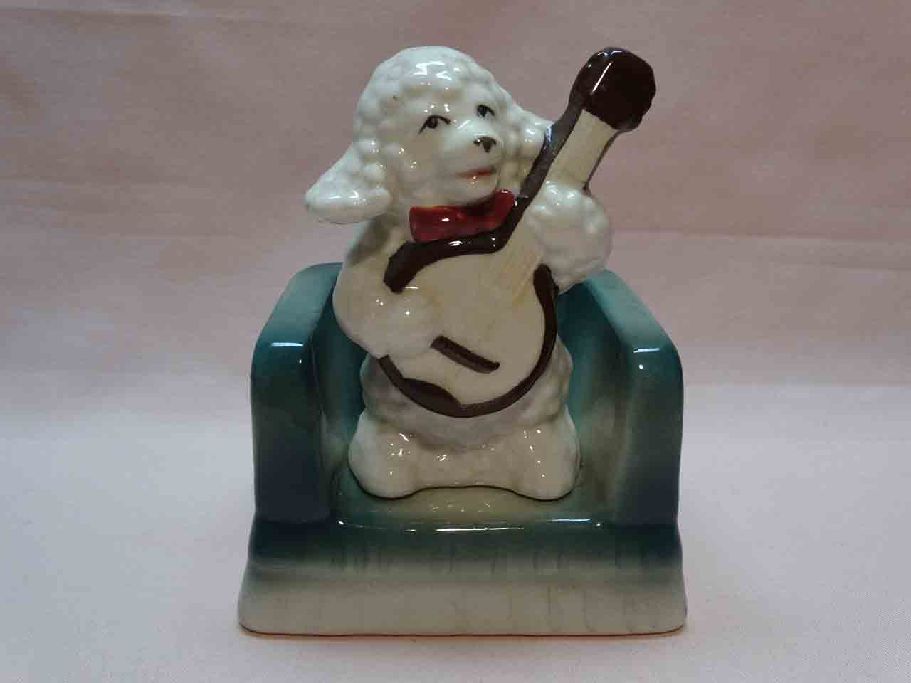 Poodle dog on chair playing banjo salt and pepper shakers